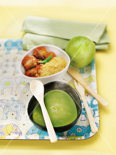 Child's meal on a tray : pea soup,meatballs,bulghour and a green apple