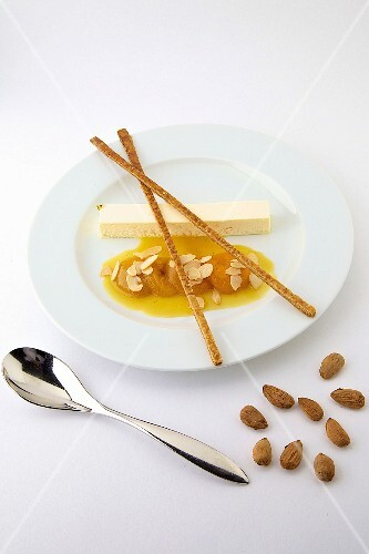 Ice cream nougat with poached apricots and almonds