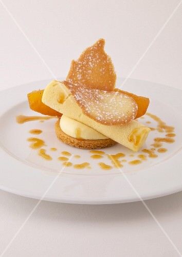 Lemon mousse,rolled sponge cake and Langue-de-chat biscuit on shortbread