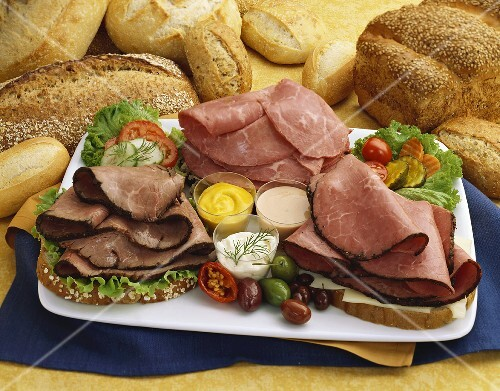 Cold Cut Platter With Roast Beef Pastrami And Corned Beef Fresh Bread And Condiments