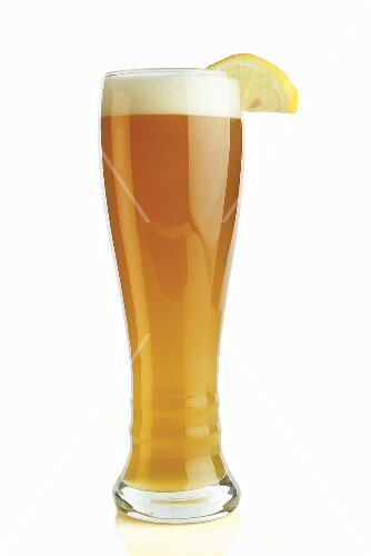 tall glass of hefe weiss beer with lemon wedge buy images stockfood. Black Bedroom Furniture Sets. Home Design Ideas