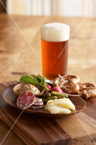Supper and a glass of beer (salami, cheese, pickles and pretzels)