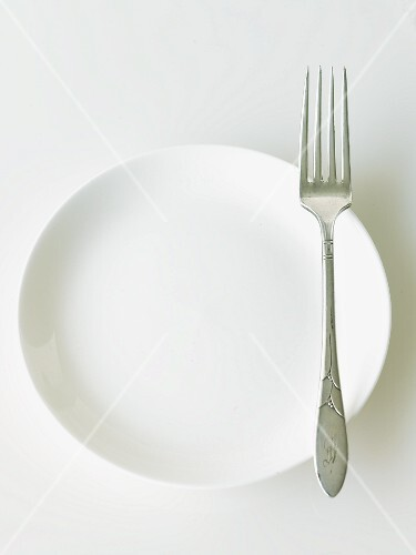 White Plate with an Antique Fork; White Background