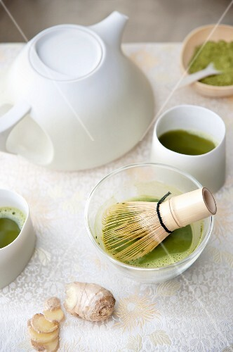 Powdered green tea with a tea whisk and an oriental teapot