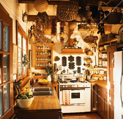A country house kitchen with baskets dried chilli peppers