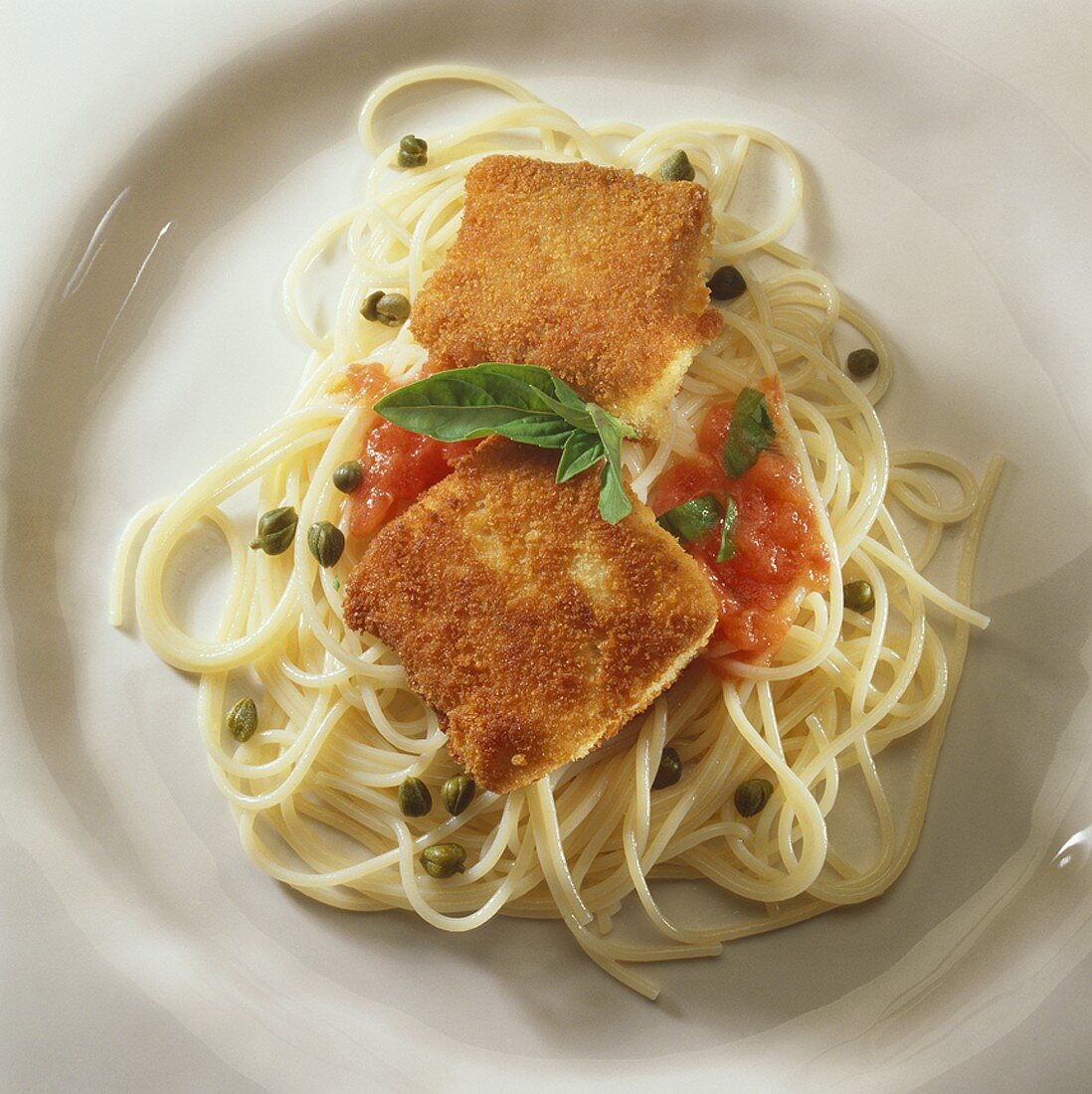 Fillet of sturgeon with capers on spaghetti