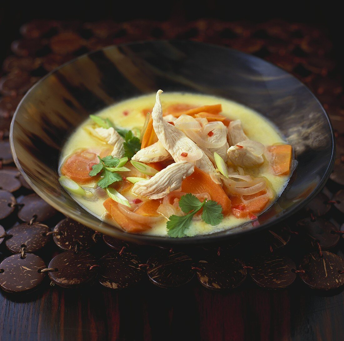 Coconut and chicken soup with vegetables