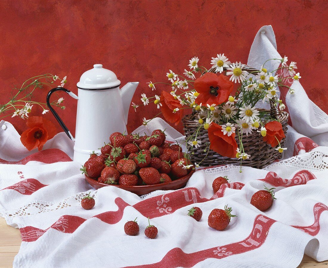 Fresh strawberries, chamomile flowers and poppies