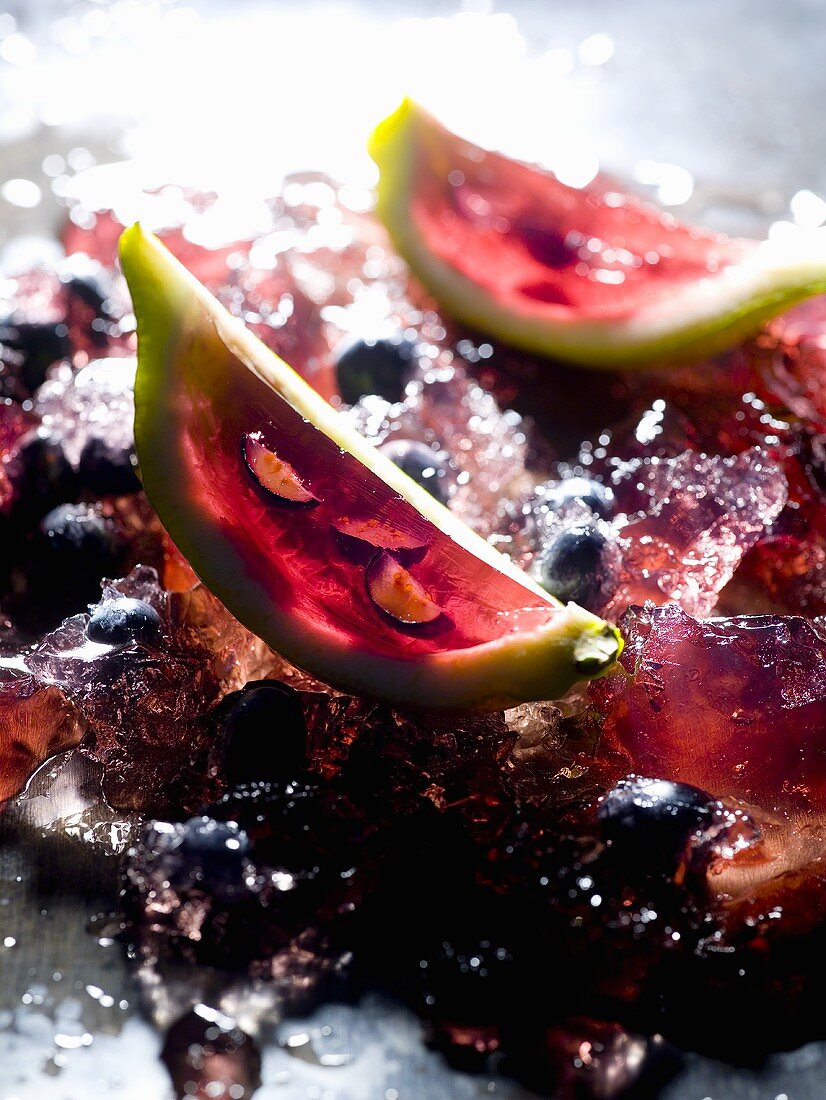 Wedge of lime filled with berries in aspic