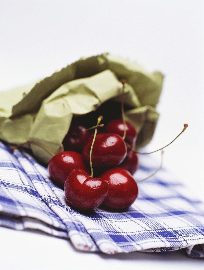Heart cherries (sweet cherries) in a paper bag