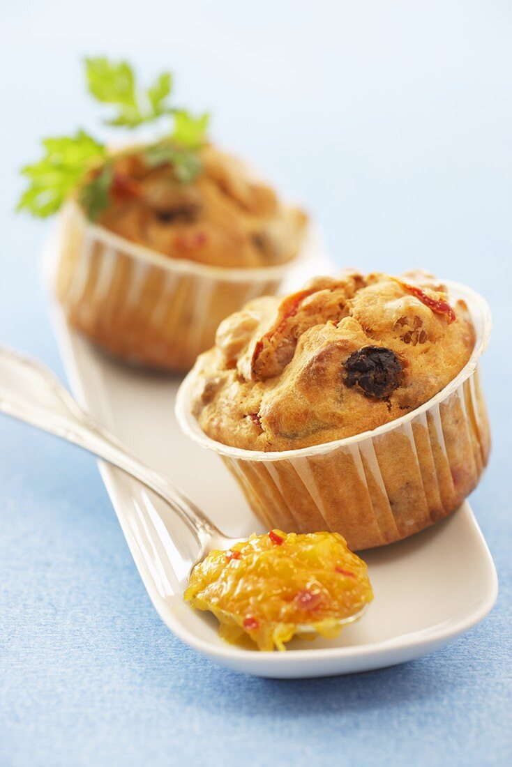 Two curry muffins with mango chutney