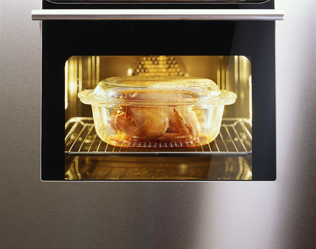 Chicken in an ovenproof dish in the oven