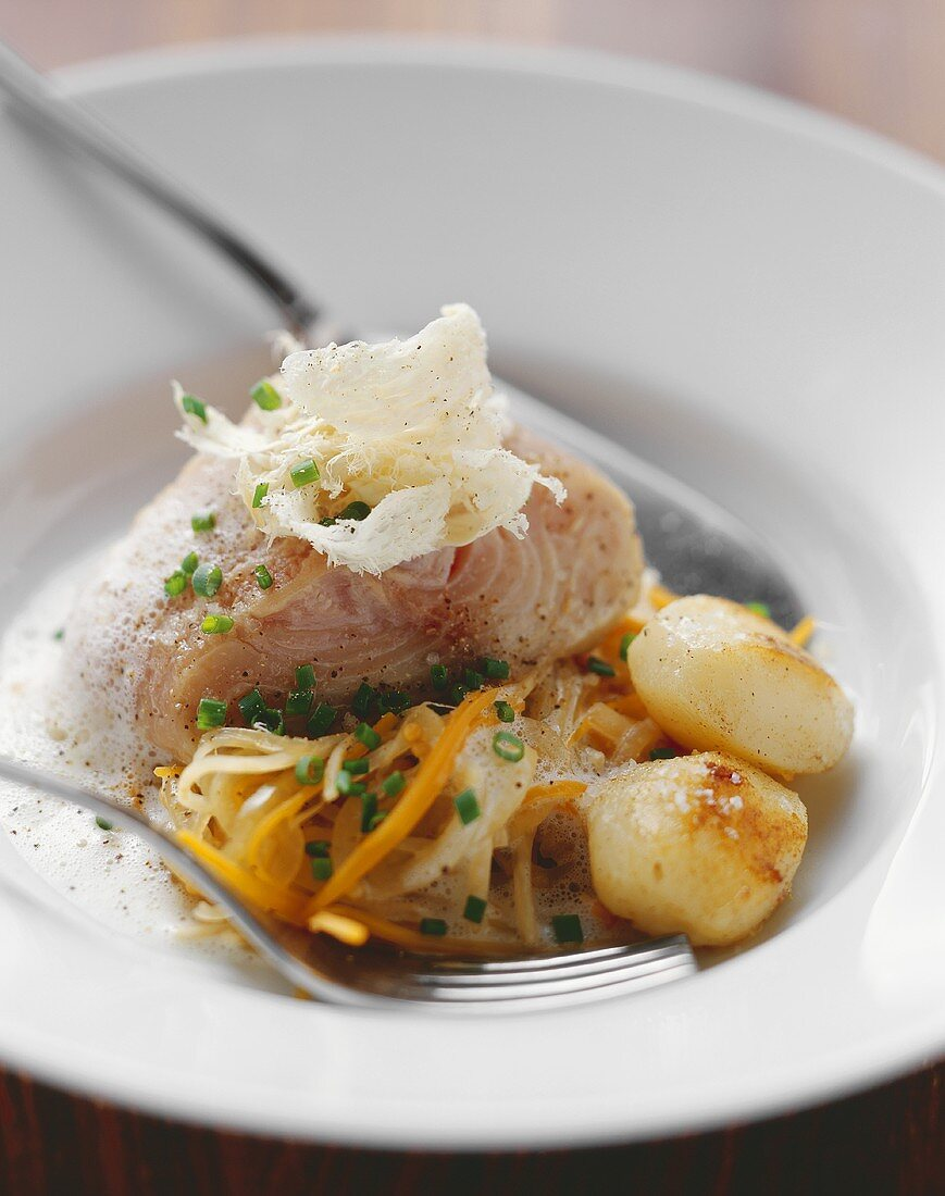 Catfish fillet cooked in root vegetable stock, with horseradish