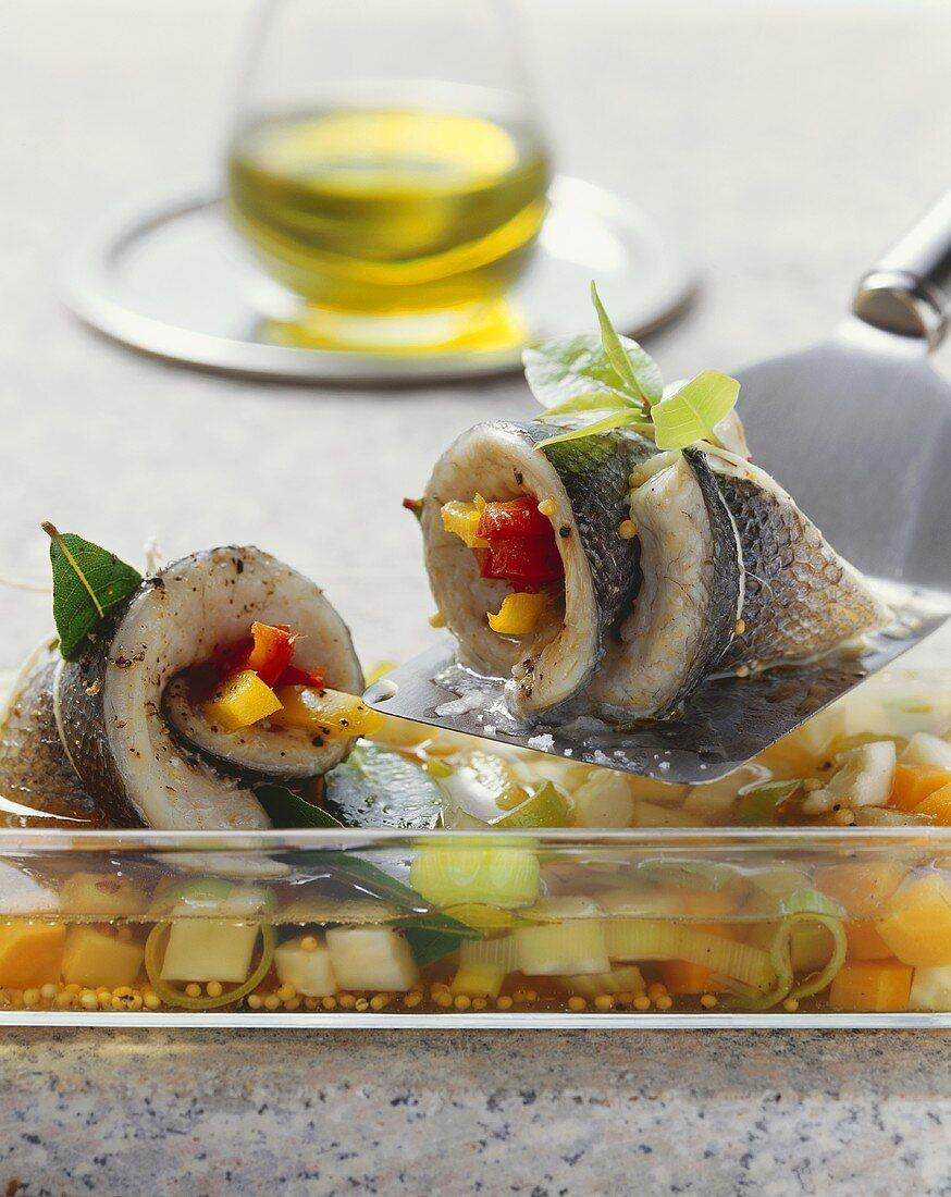Branzino in agro (Sea bass rolls in wine & vegetable stock)