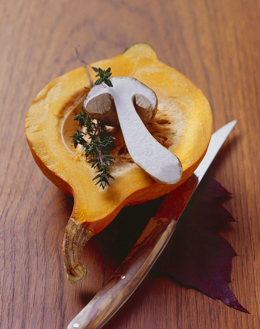 Autumn still life: Hokkaido squash with cep and thyme