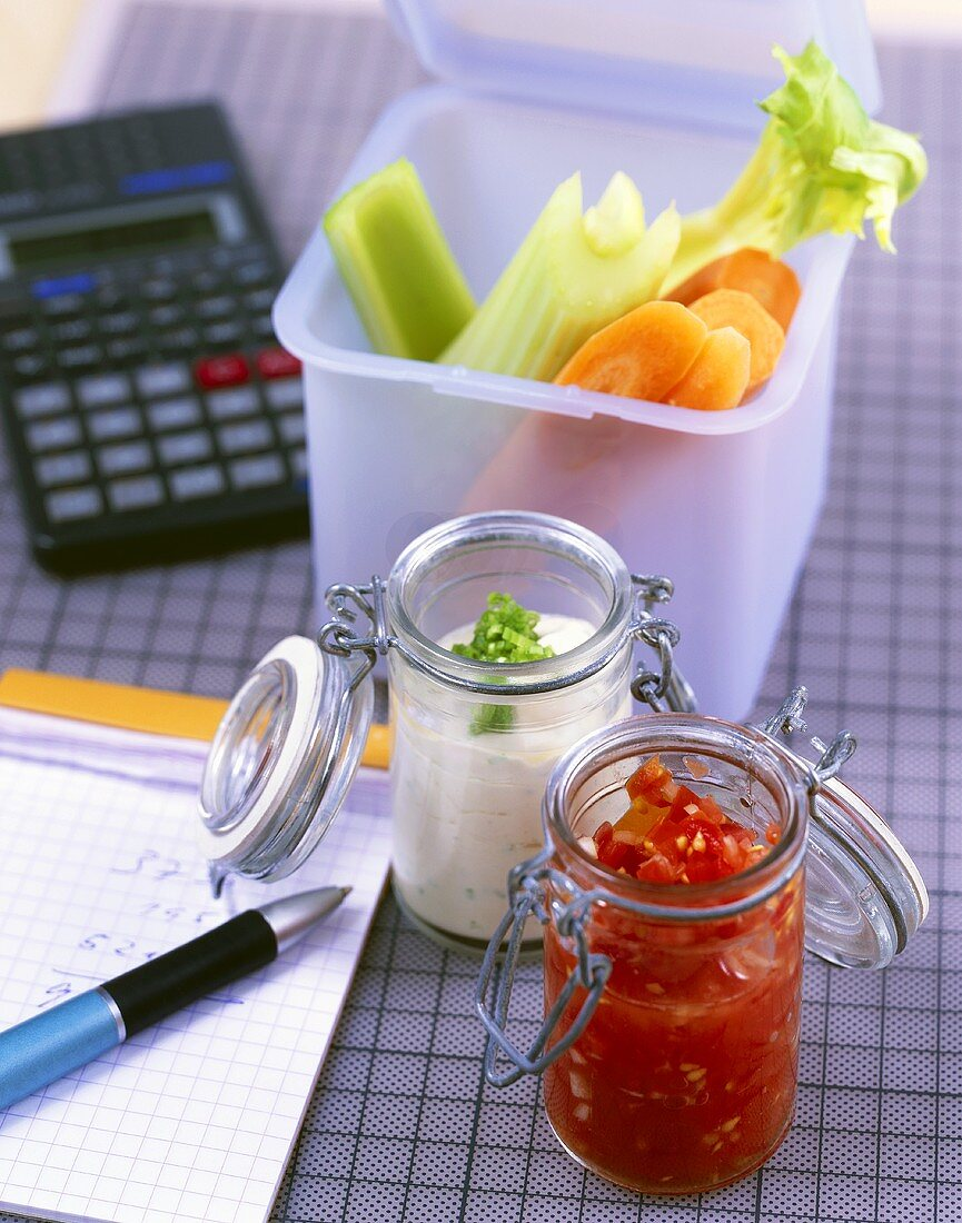 Healthy break-time snack with vegetable sticks and dips