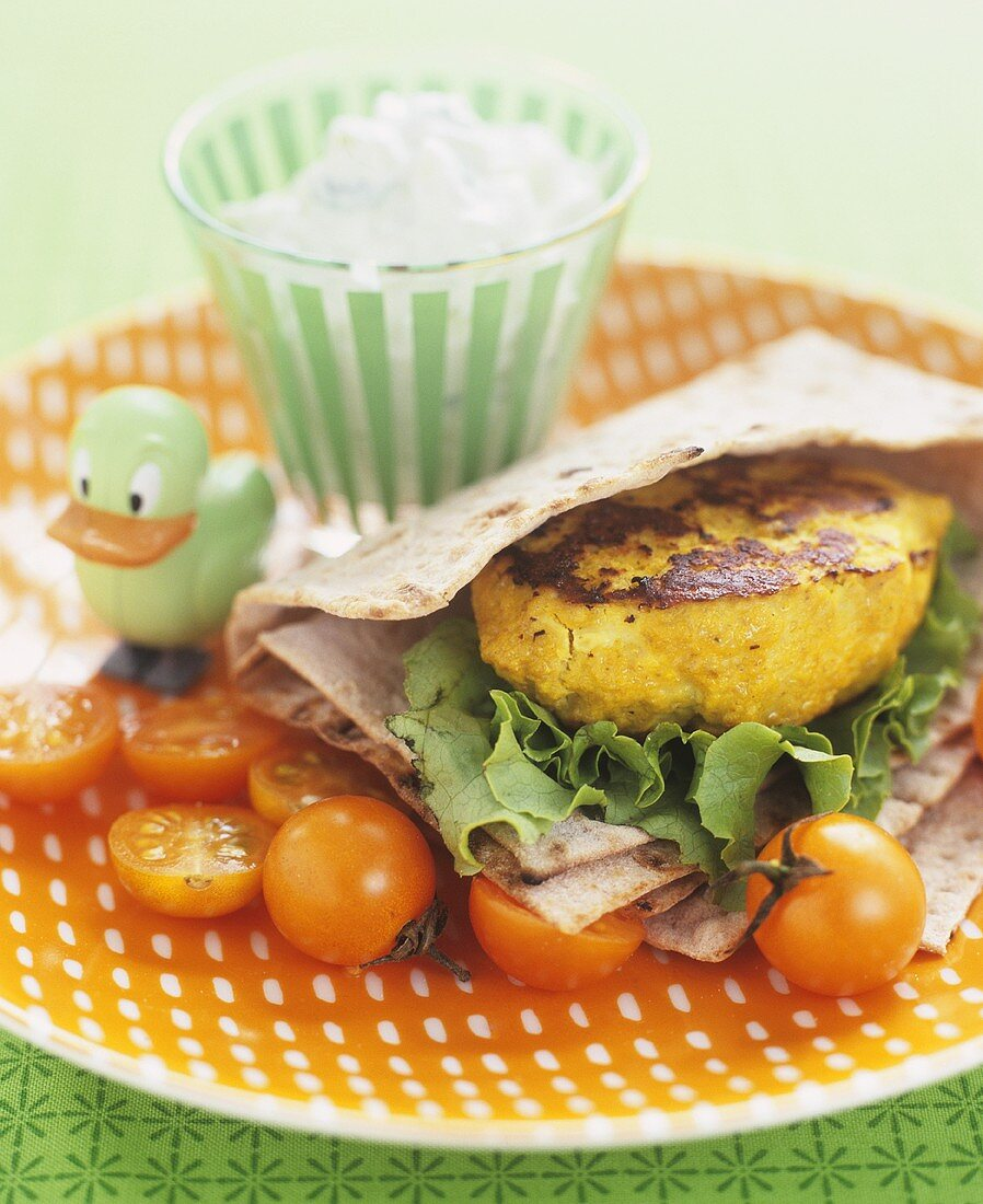 Vegetable burger in flatbread with cocktail tomatoes