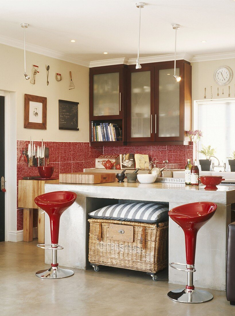 Bar stools in front of a kitchen unit