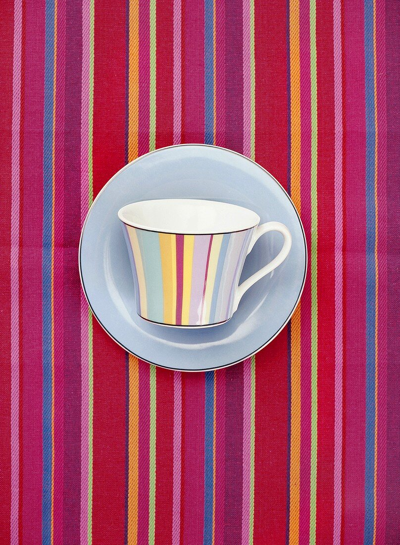 Striped cup on striped tablecloth