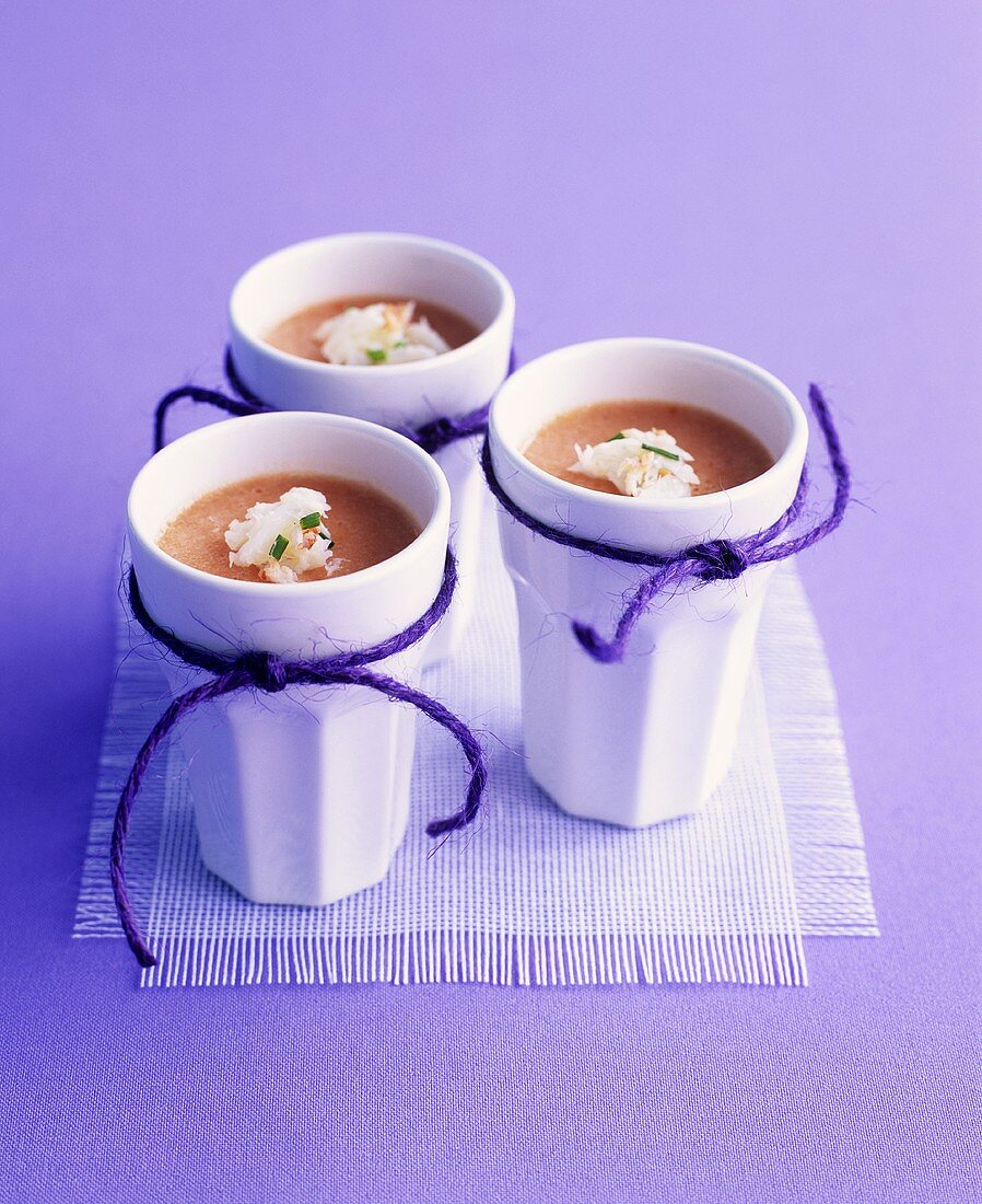 Three beakers of gazpacho jelly with crabmeat