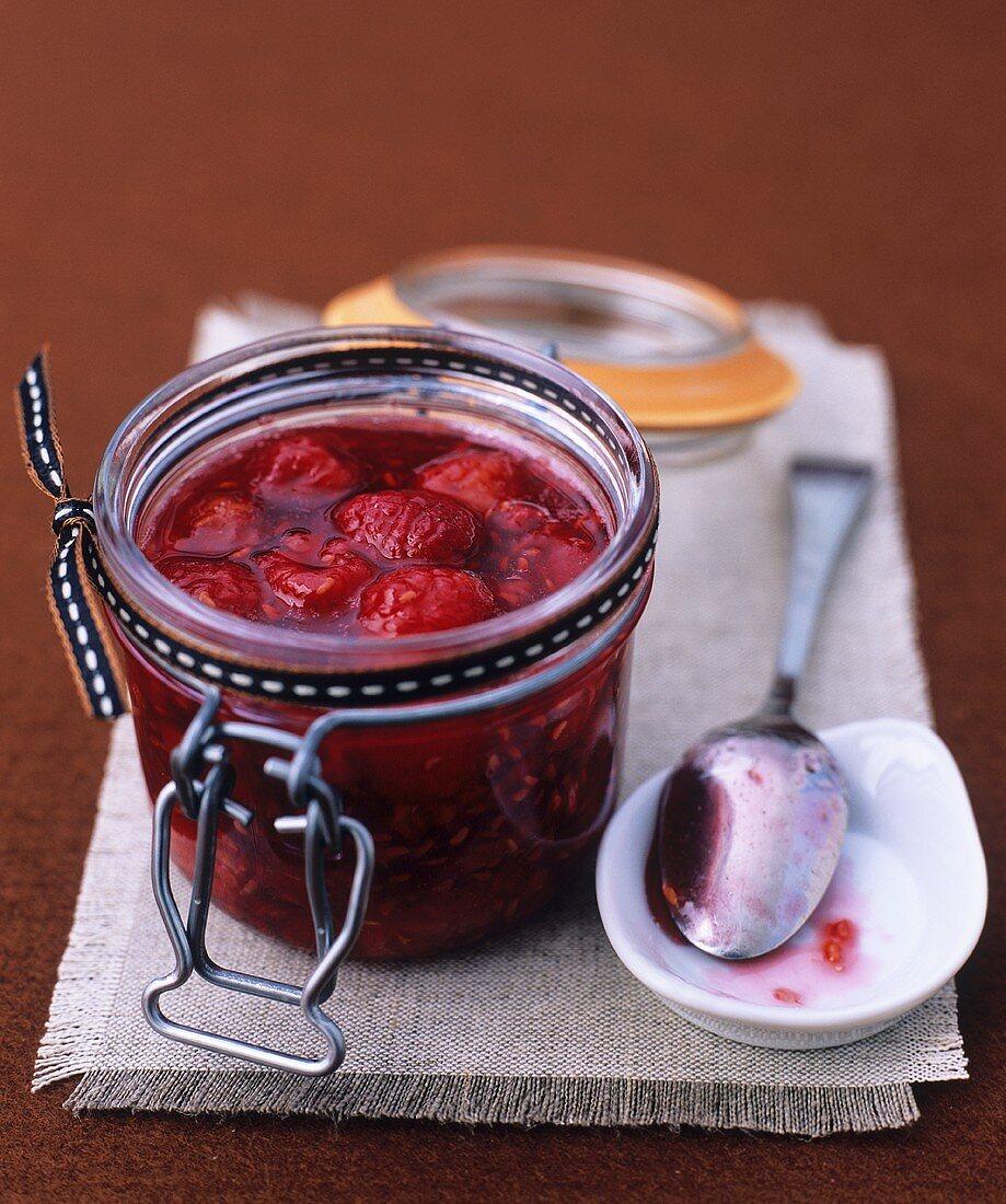 Baked raspberry jam in a preserving jar