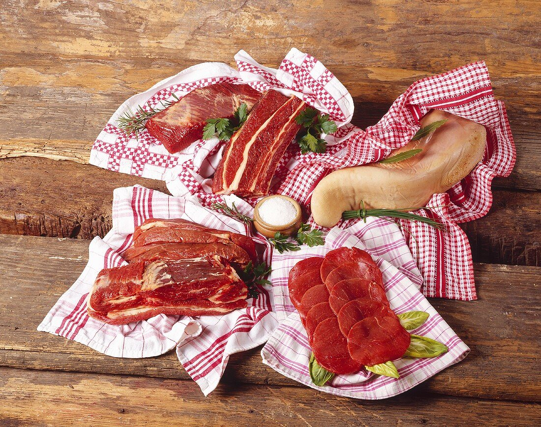 Various cuts of meat on tea towels