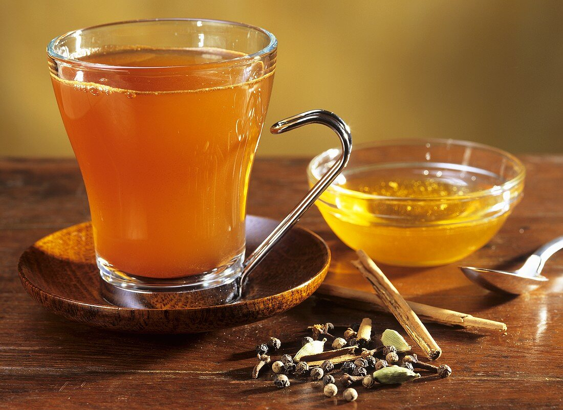 Winter drink of green tea, spices and honey