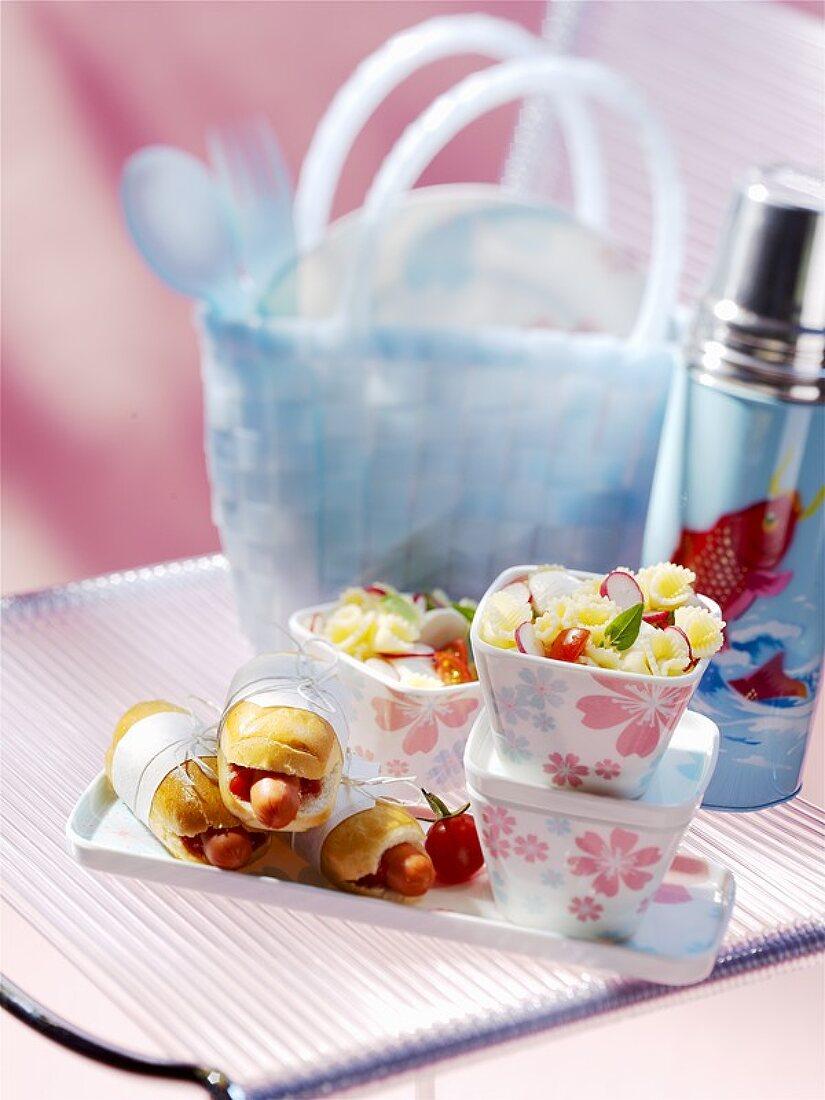 Pasta salad, hot dogs, picnic things