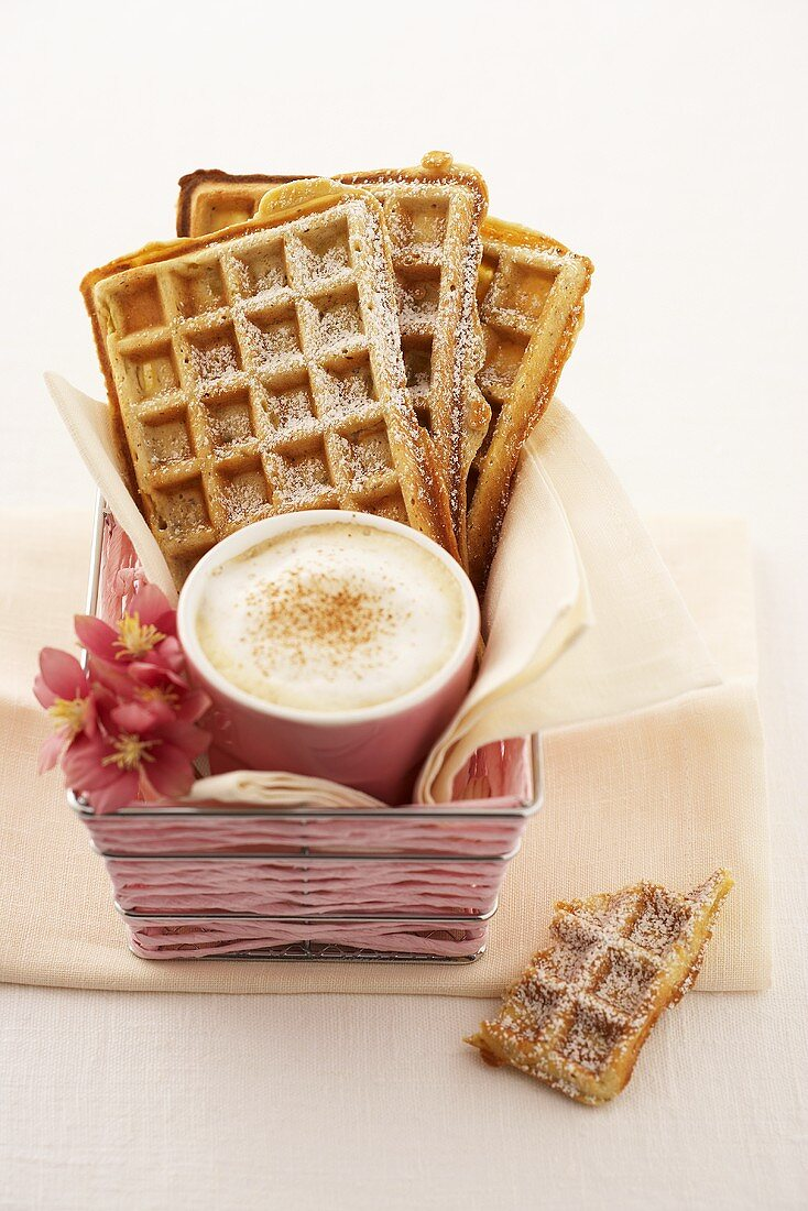 Apple and nut waffles and a cup of cappuccino