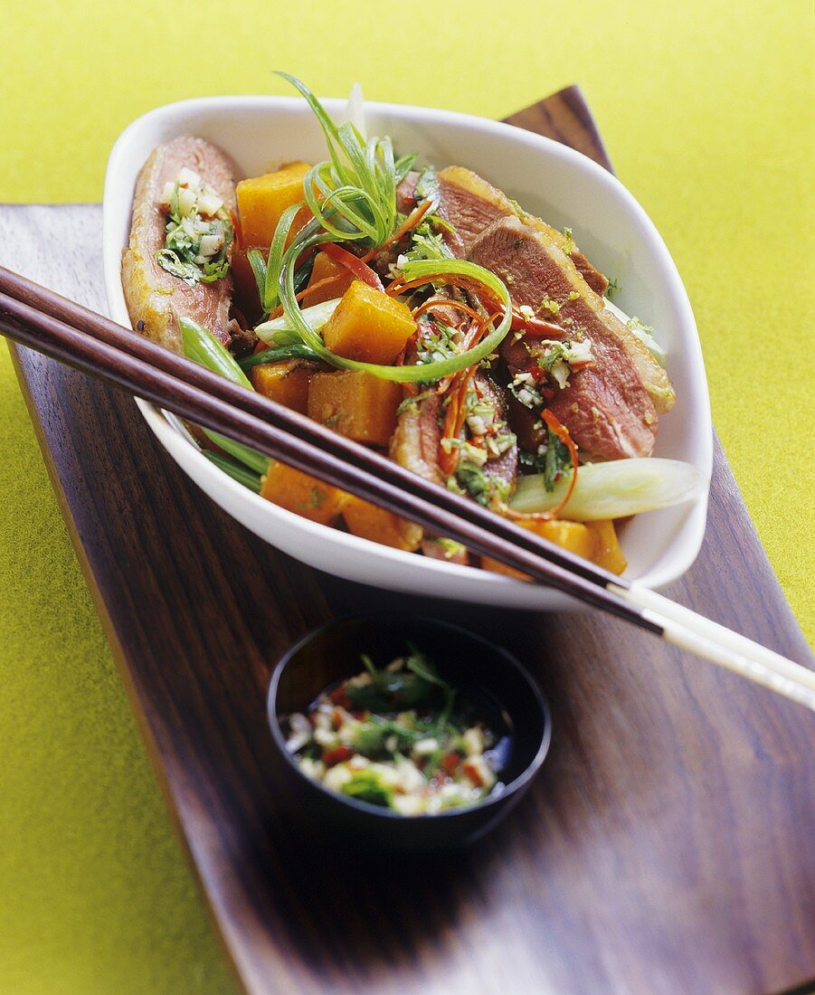 Duck breast on spicy pumpkin curry