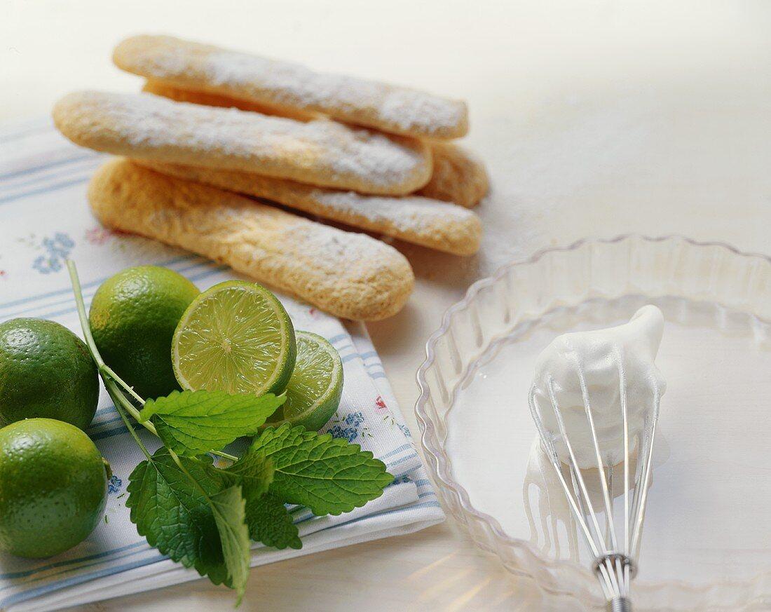 Whisk, beaten egg white, tart dish, limes, sponge fingers