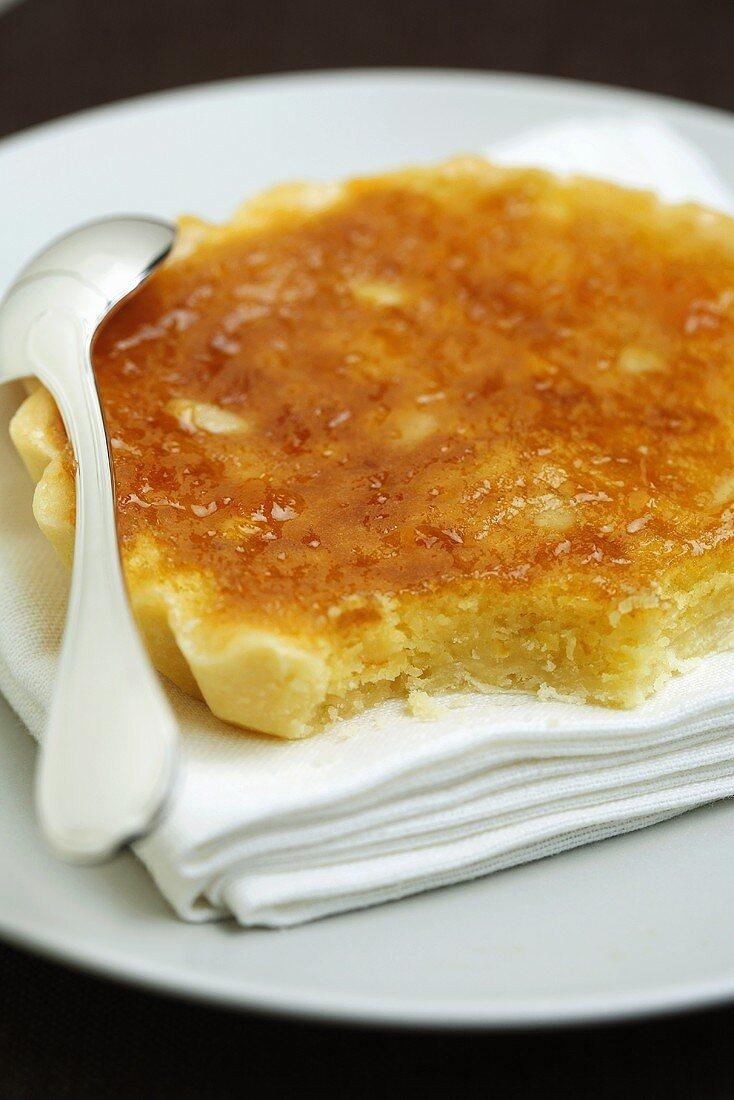 Amandine (almond tart) with orange and pine nuts