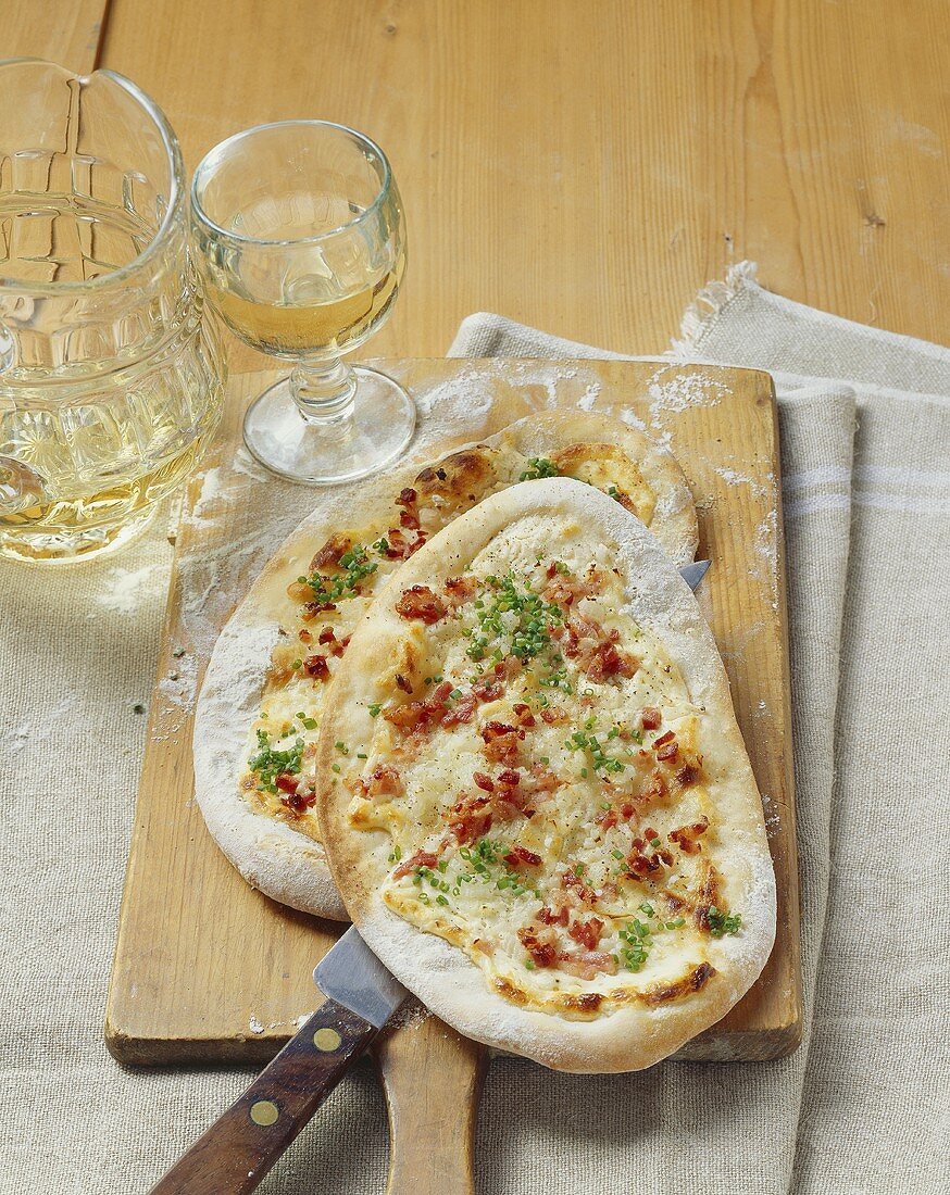 Tartes flambées with traditional onion and bacon topping