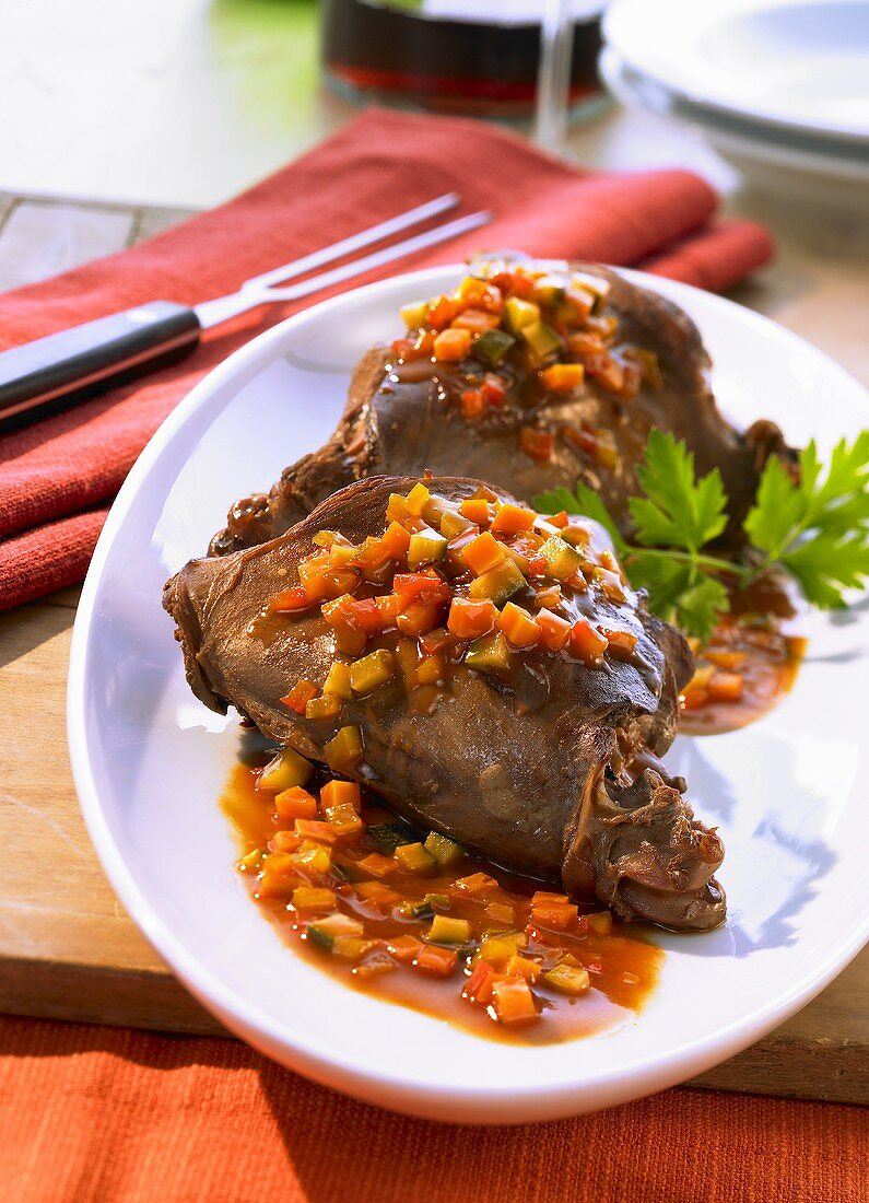 Roasted legs of hare with sweet and sour sauce