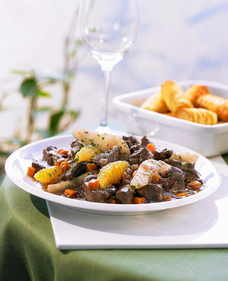 Venison goulash with pears, oranges and potato croquettes