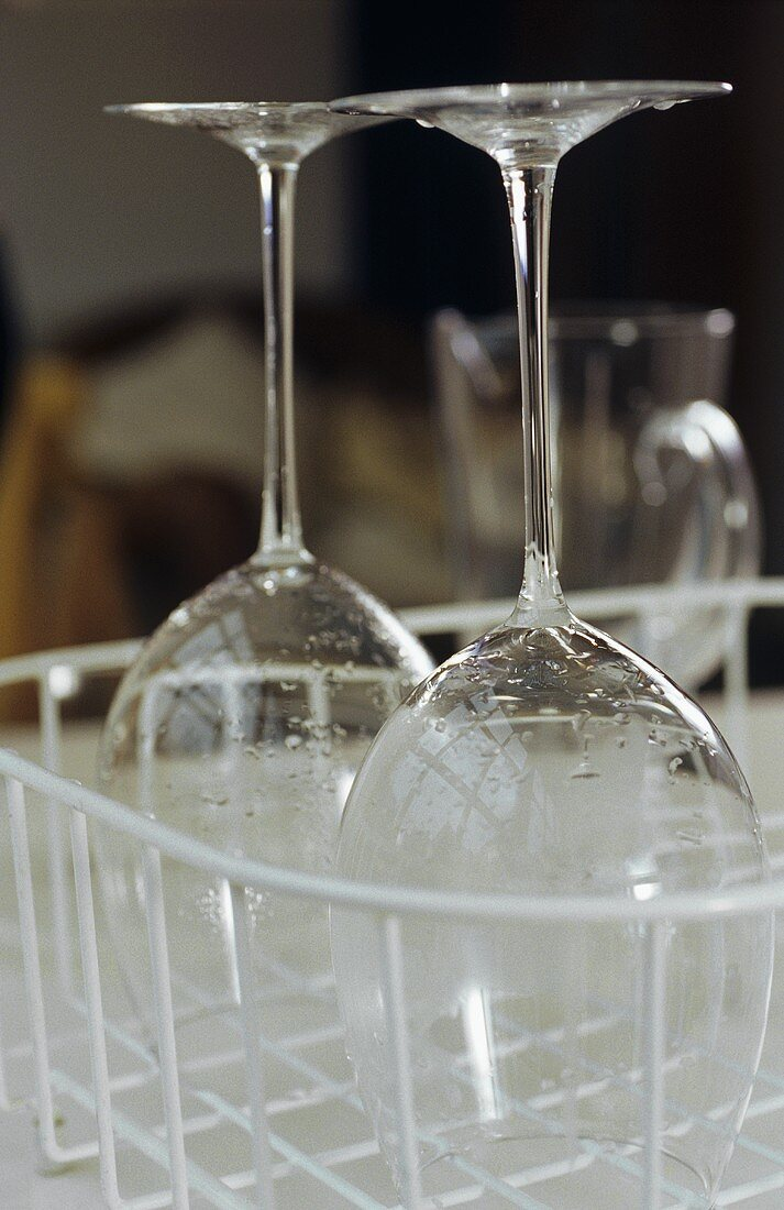Two wine glasses in a draining rack