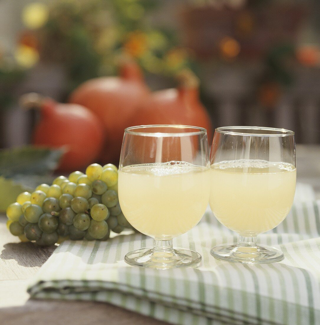 Two glasses of Federweisser (new wine) with grapes