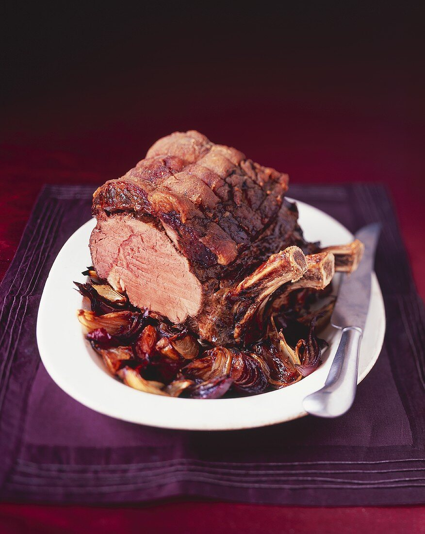 Roast rib of beef with port wine sauce and balsamic onions