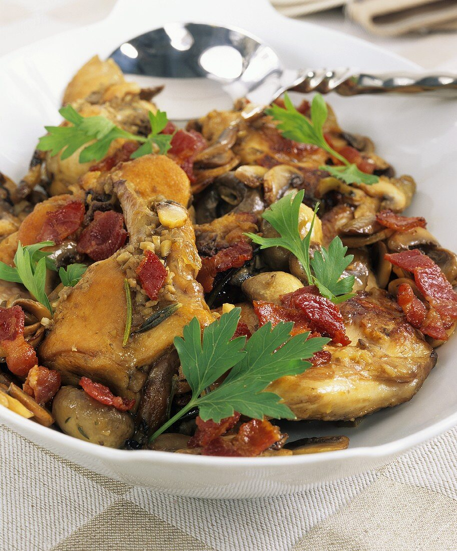 Braised rabbit with onions and mushrooms on platter