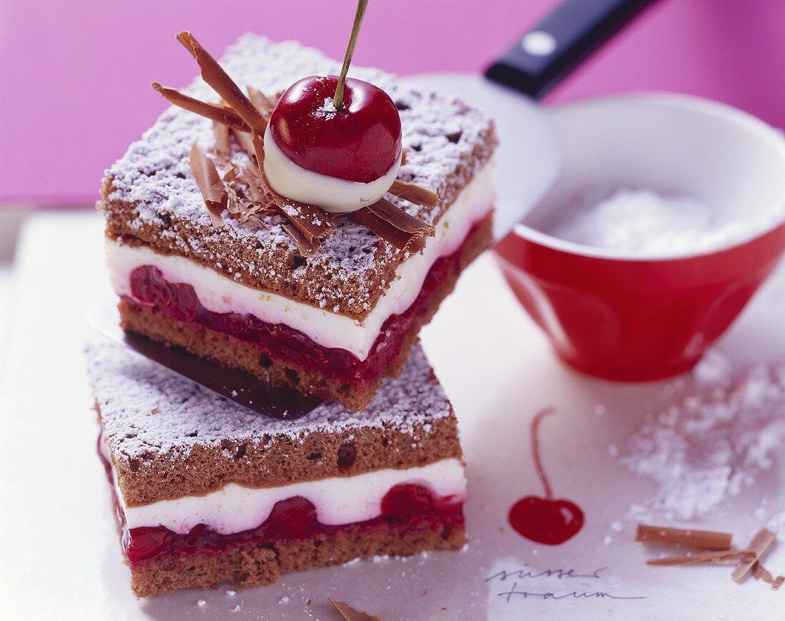 Chocolate sponge slices with cherries and yoghurt cream