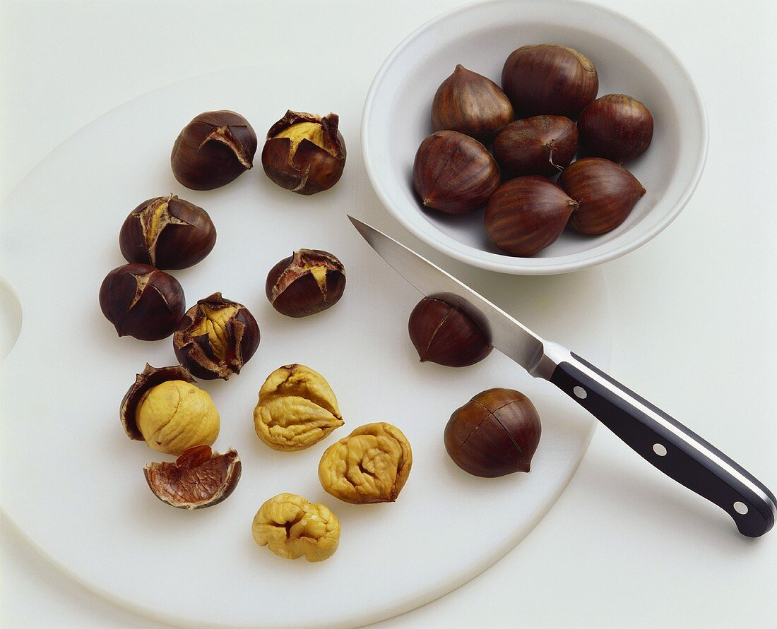 Scoring and shelling chestnuts