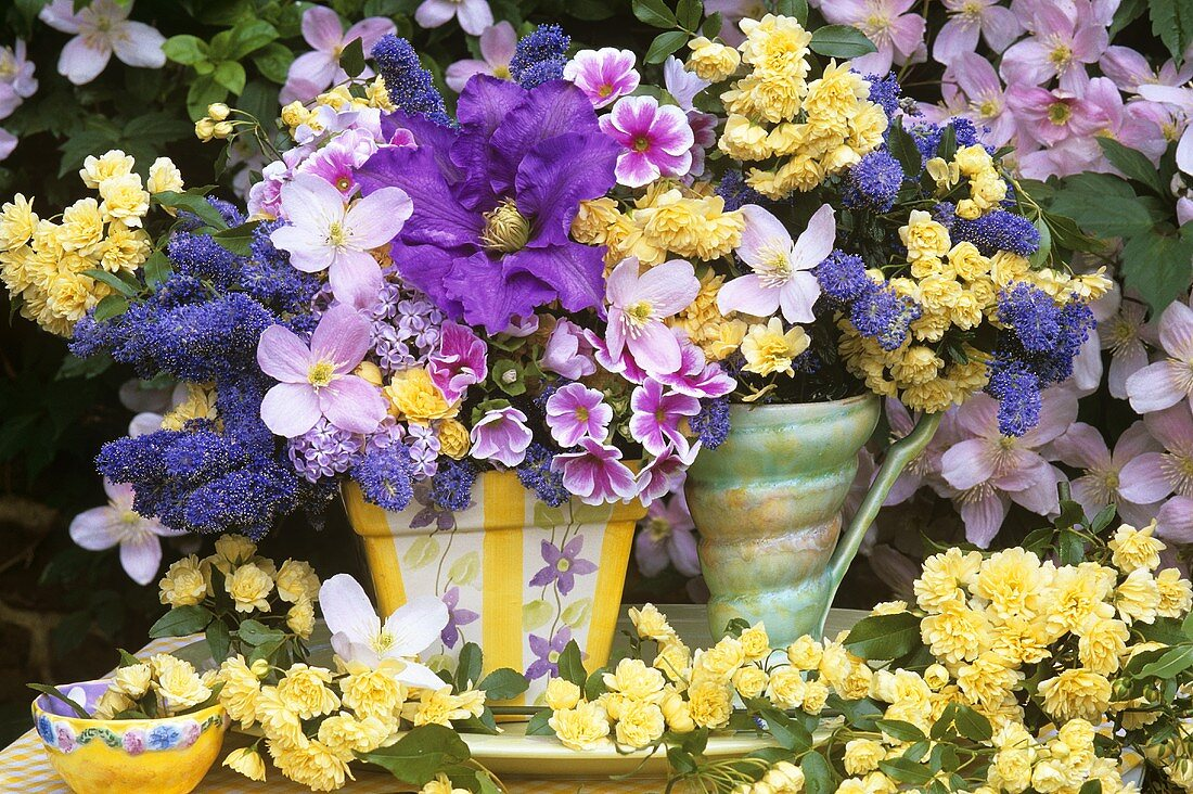 Spring flowers in vases out of doors