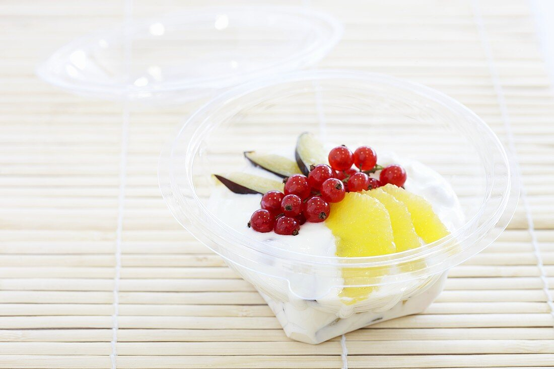 Fruit quark in a plastic bowl to take away