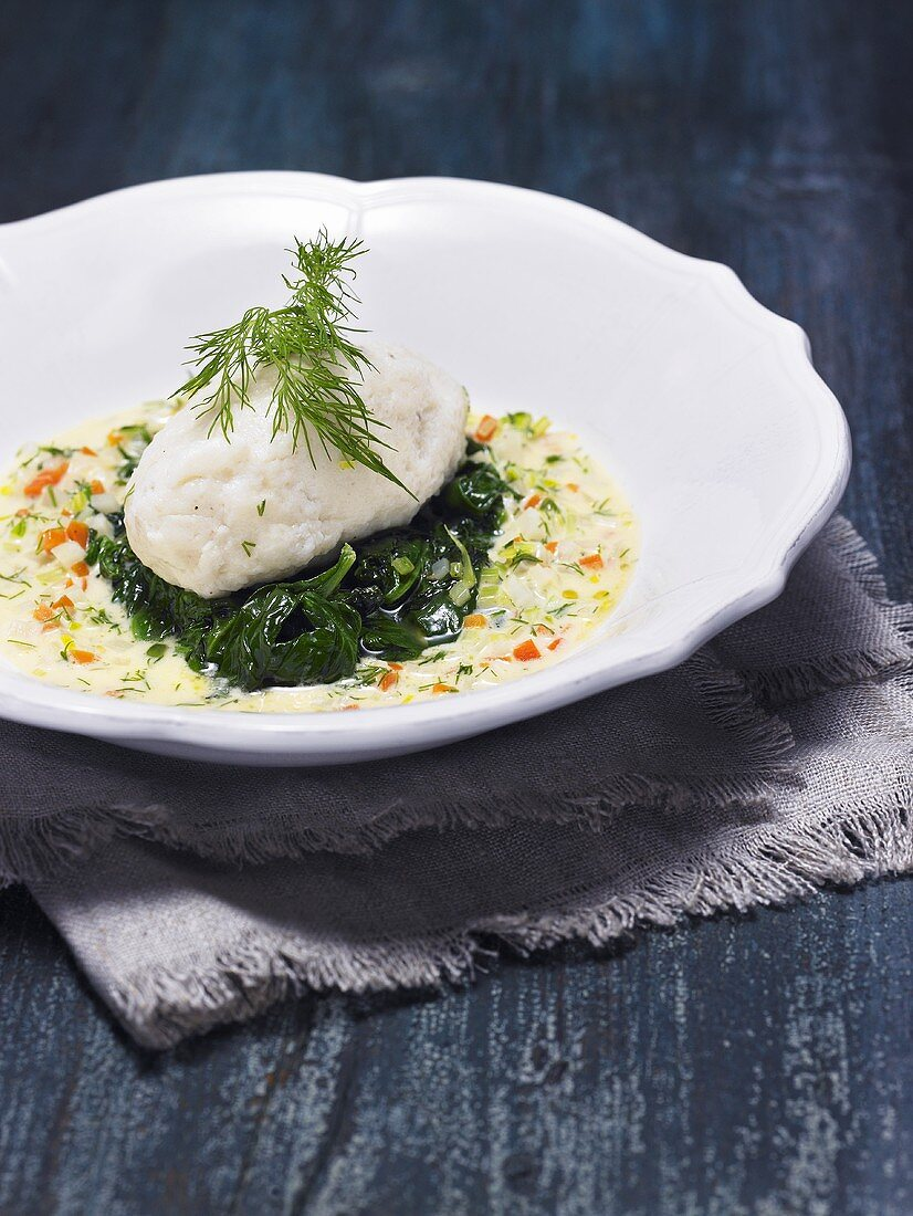 Hake gnocchi with spinach in a vegetable sauce