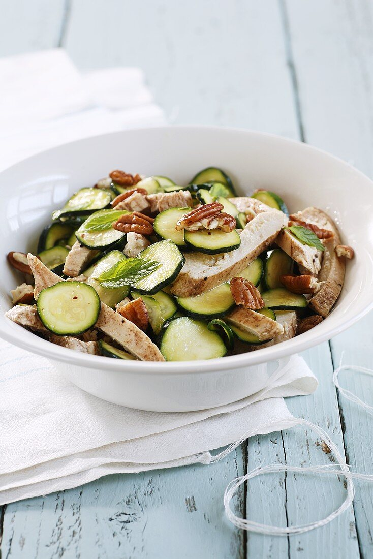 Courgette salad with chicken, nuts and mint