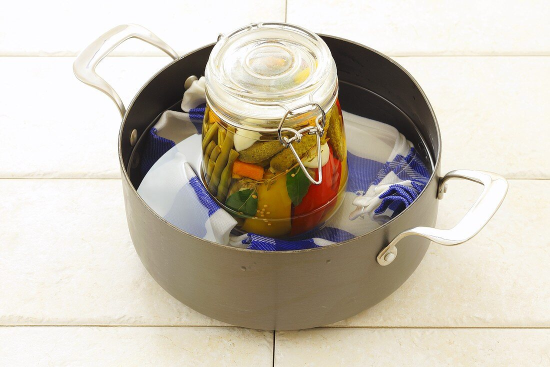 Heating pickled vegetables in a bain marie