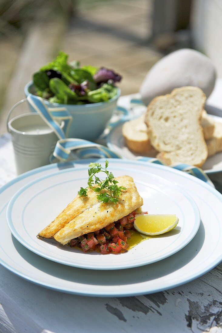 Sea bream with salsa, bread and salad