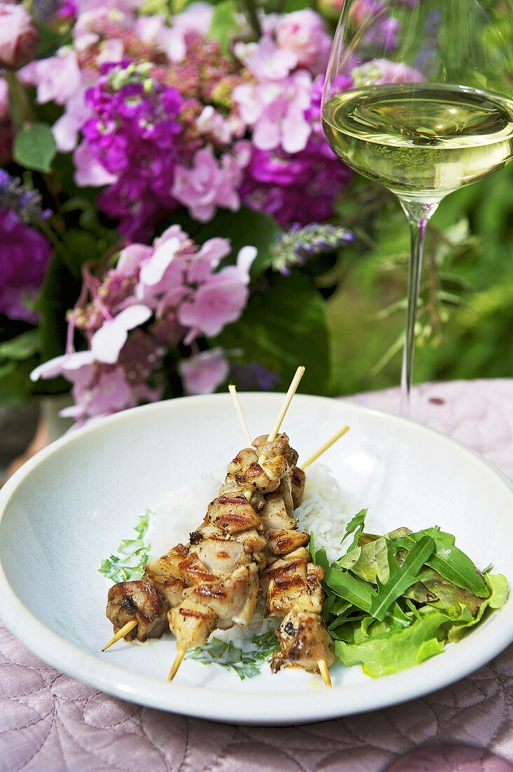 Chicken kebabs with ginger and salad