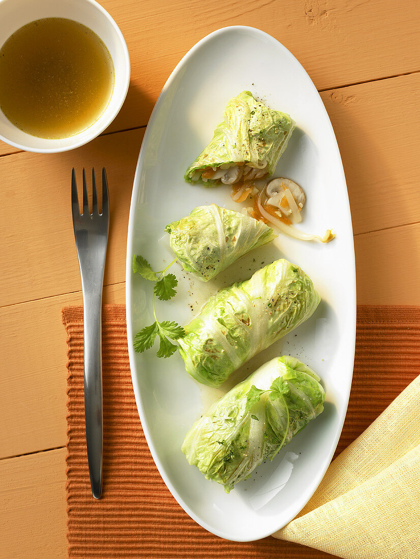 Three Chinese cabbage leaves stuffed with vegetables