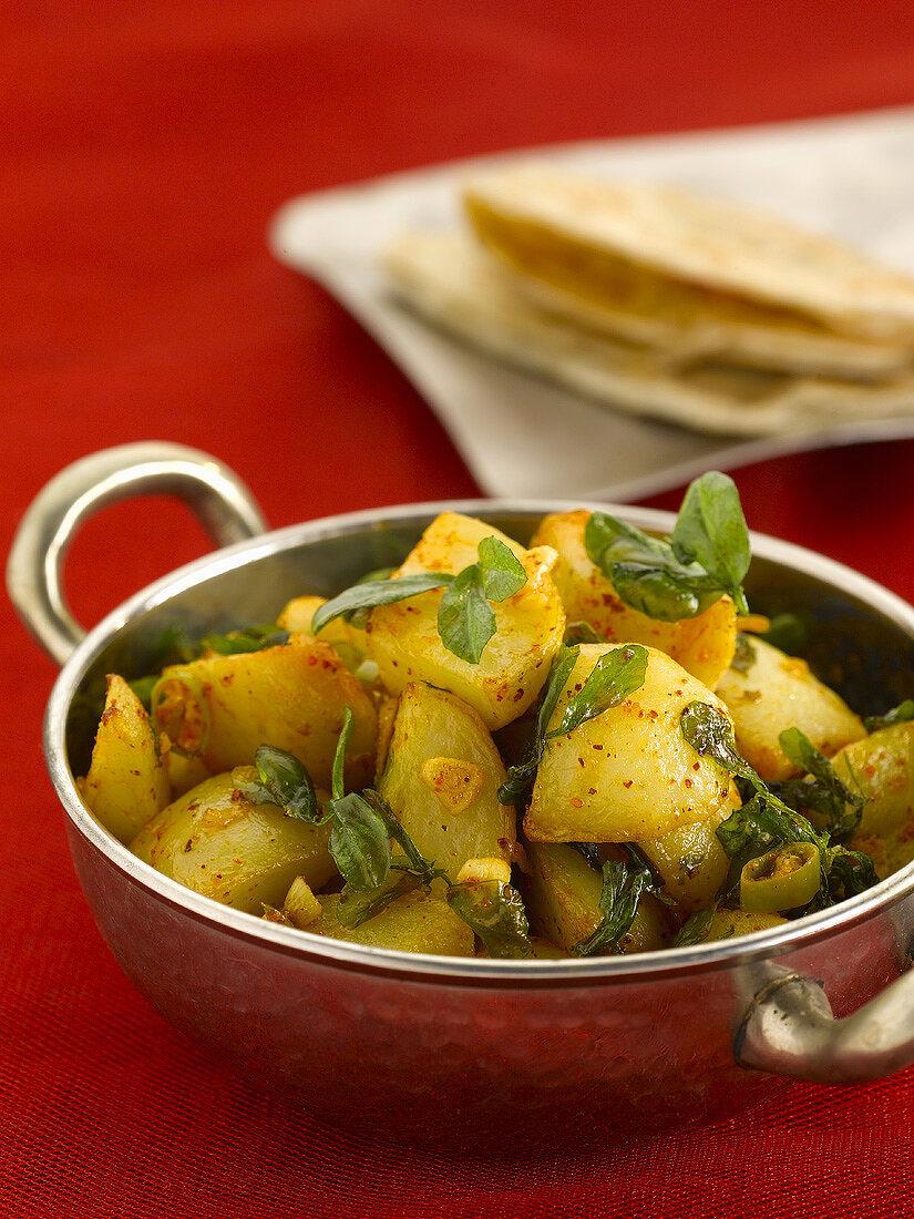 Aloo methi (Curried potatoes with fenugreek, India)